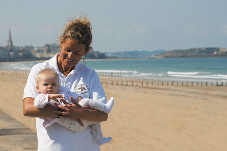 A nurse takes care of a baby at the Grand Hotel des Thermes in Saint Malo