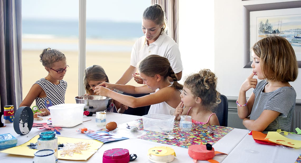 Kids cook with an animator from the kids-club at the Grand Hotel des Thermes in Saint Malo