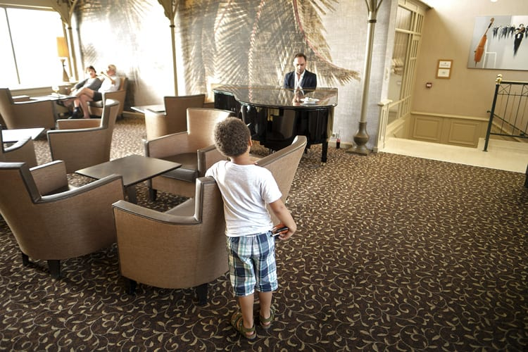 Kid listening to the piano
