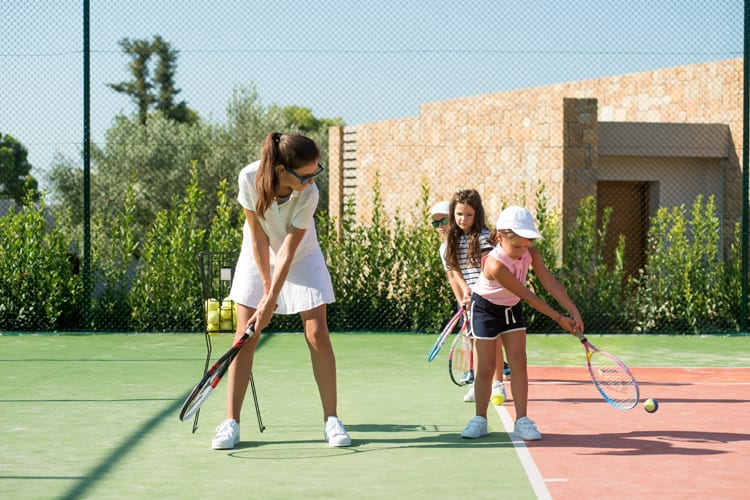 Tennis lesson at the Ikos Kids' Club