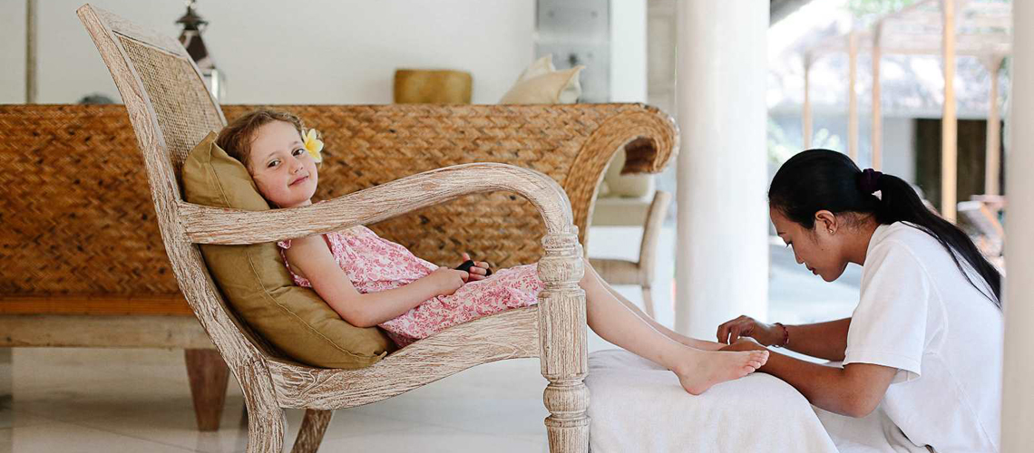 A little girl enjoys her relax pedicure moment at Villa Sungai in Thailand