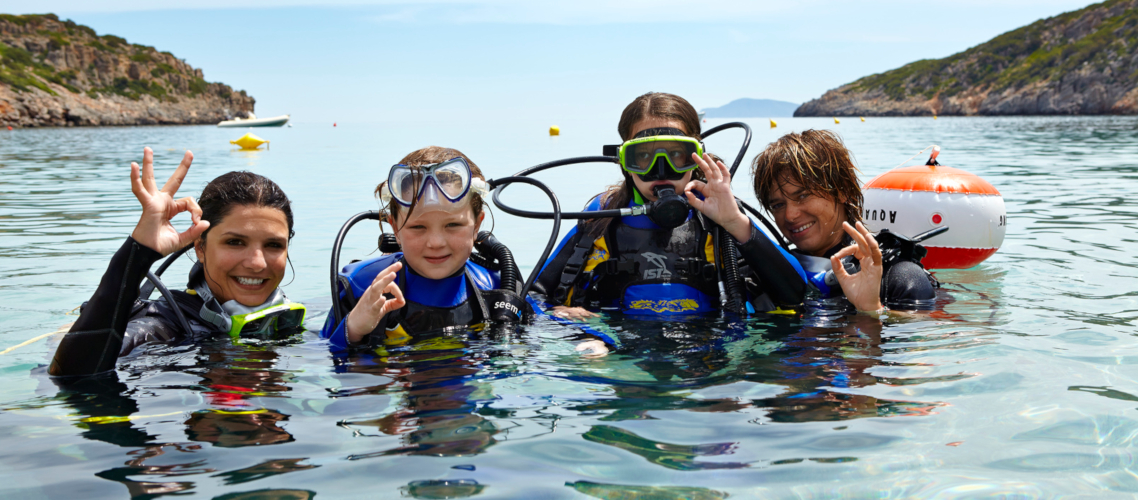 Little Guest Hotels Collection Family diving scuba in water.jpg