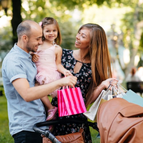 Family with shopping bag in a city