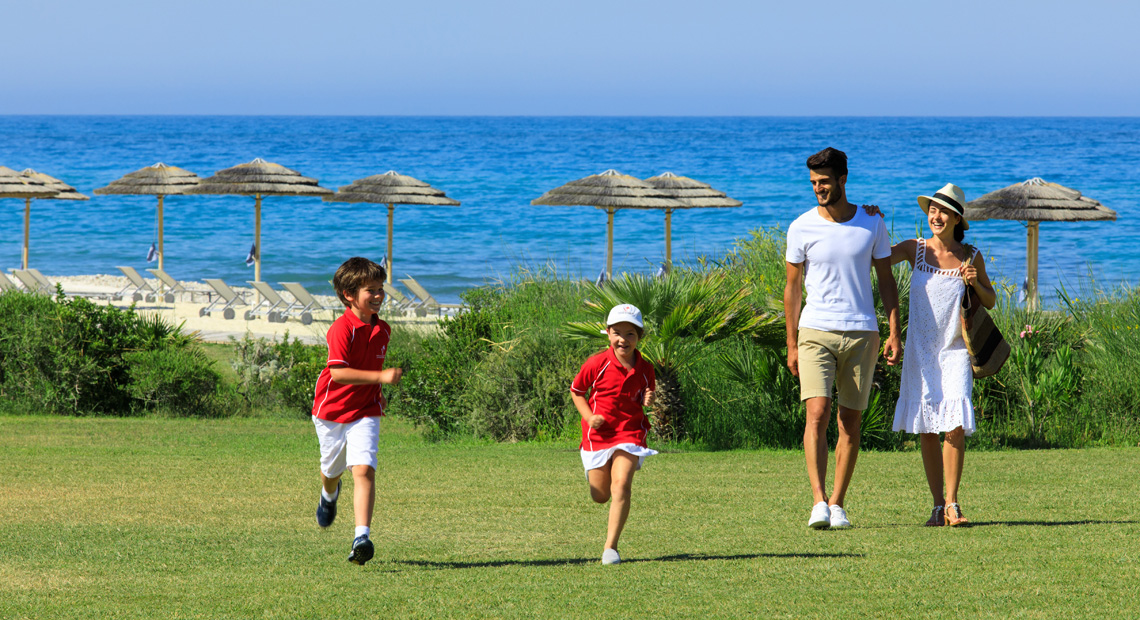 A family plays on the grass atthe Verdura Resort in sicily