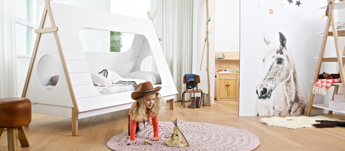 A sweet babygirl plays the cowgirl in her beautiful designed bedroom