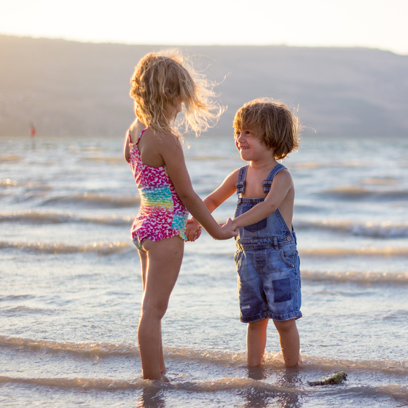 Two kids play on the beach