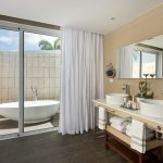Bathroom with outdoor bathtub at Nickelodeon Hotels & Resorts Punta Cana