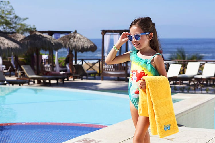 A little girl walks near the outdoor pool at Grand Palladium Costa Mujeres Resort & Spa