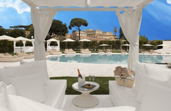 Gran Meliá Rome Villa Agrippina drinking champagne by the pool