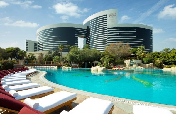 Grand Hyatt Dubai pools surrounded with trees