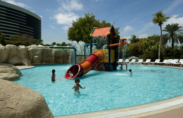 Children playing in the kids pool at Grand Hyatt Dubai