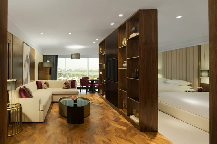 Grand Hyatt Dubai suite with double bedroom, living room  and view on the skyline
