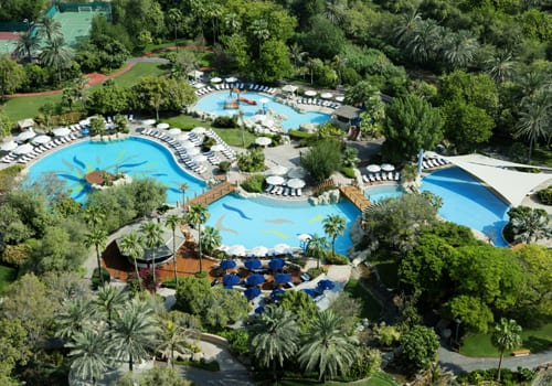 Grand Hyatt Dubai pools surrounded with trees viewed from the sky