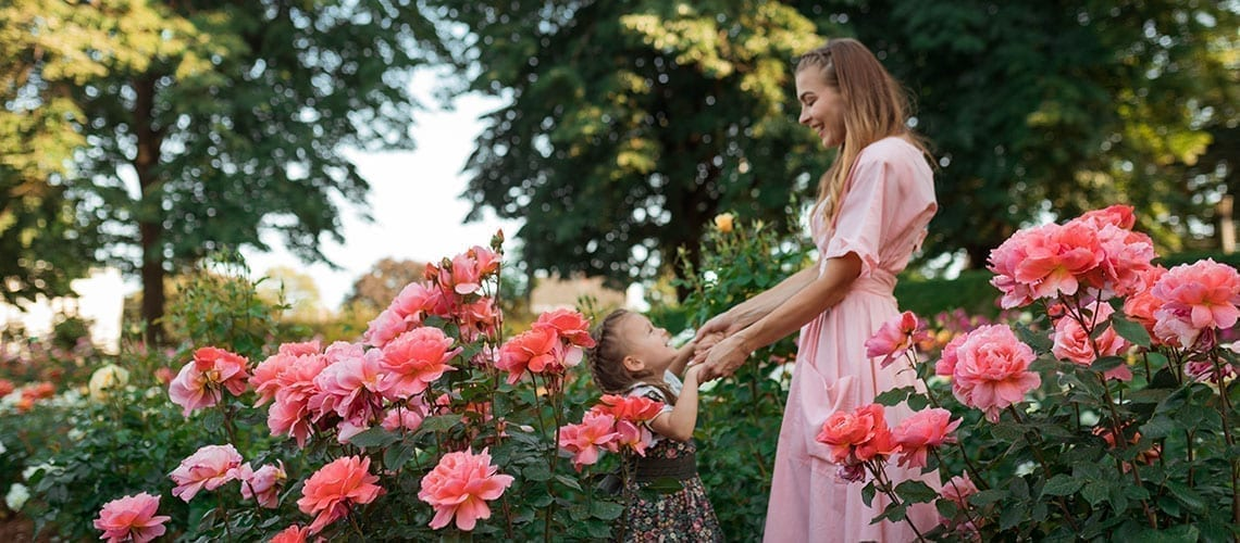 Mother and daughter in the flowers