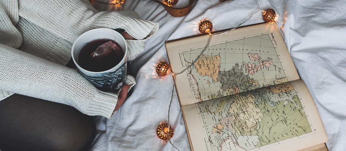 Woman, coffee and world's map