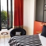 Bedroom with Eiffel Tower view Terrass'' Hotel ****
