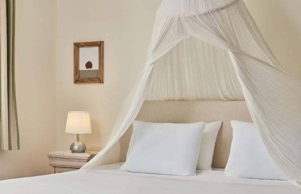 Bed in a room of Candia Park Village