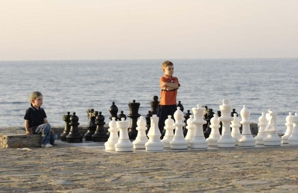 Children playing with big chess on the beach at Nana Golden Beach
