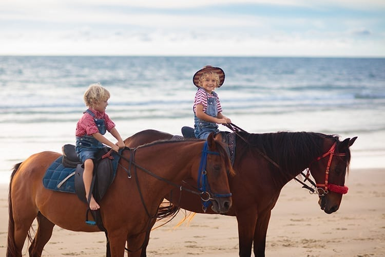 Children horse riding on the beach at Nana Golden Beach