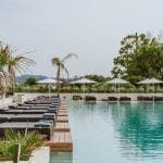 Gennadi Grand Resort infinity pool with sun deckchairs