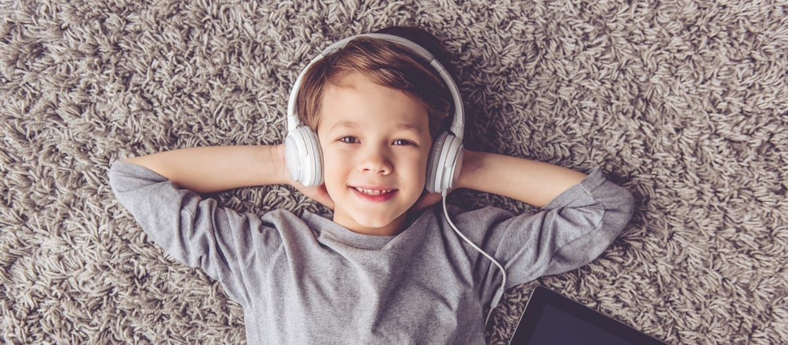 Article Podcasts - little boy listening music