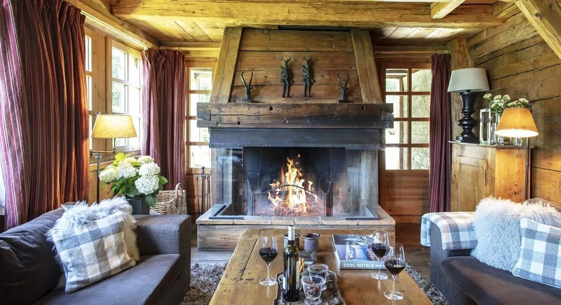 Le Chalet Chatel living room with fireplace