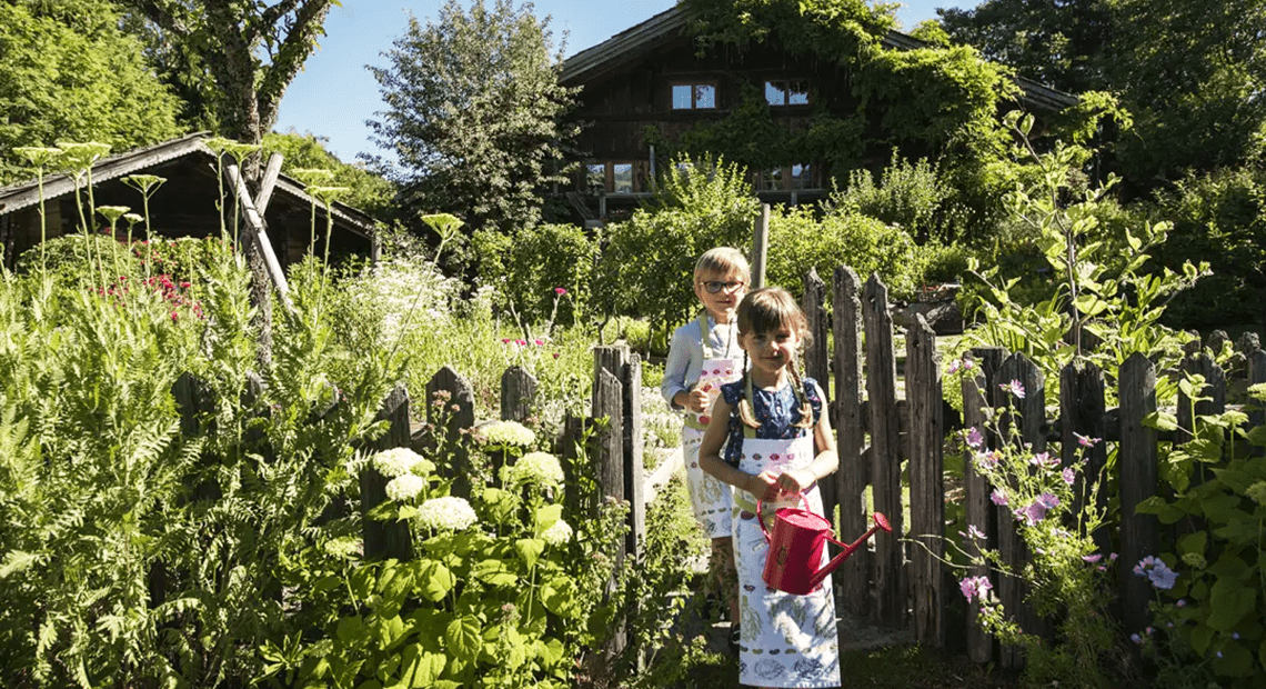 Le Chalet Chatel kids playing in the vegetable garden
