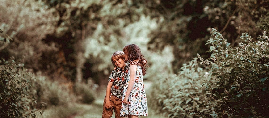 Siblings enjoying a walk in the nature