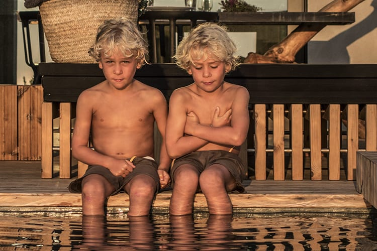 Villas at Areais do Seixo two boys by the pool