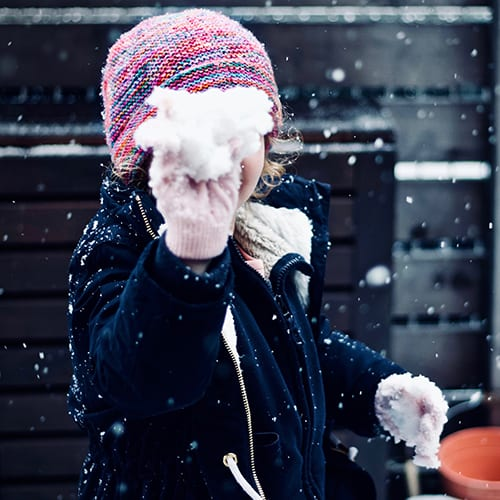 Child playing with snow